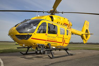 Yellow East Anglia Air Ambulance helicopter